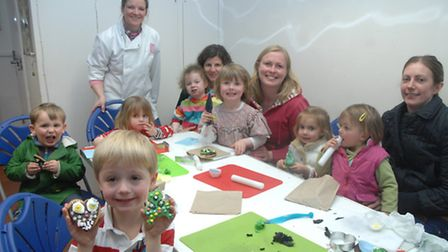 Four-year-old Lucas Cleaver (front) was just one of the children who enjoyed biscuit making at the m