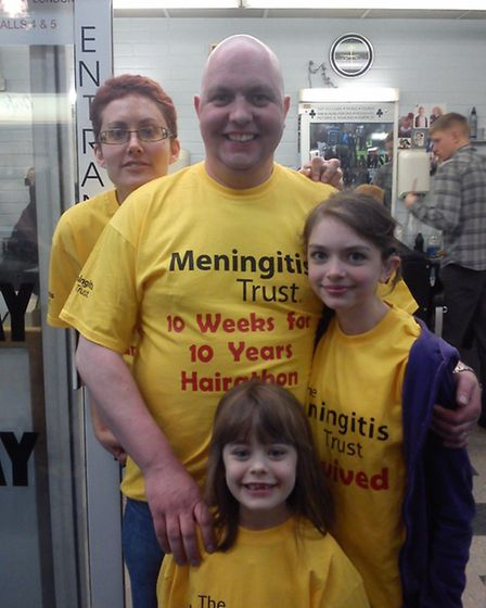 Gavin Kelso and his family after having his hair and beard shaved off at Clubman of London barbers a