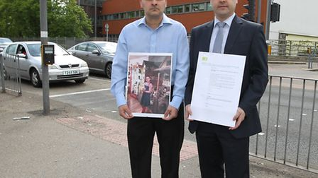 Toufik Moumen and Stevenage MP Stephen McPartland with the petition and a picture of Mr Moumen's dau
