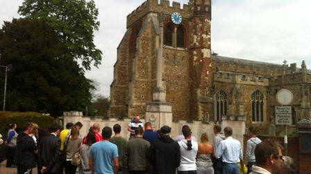 The group gather at Hitchin's war memorial