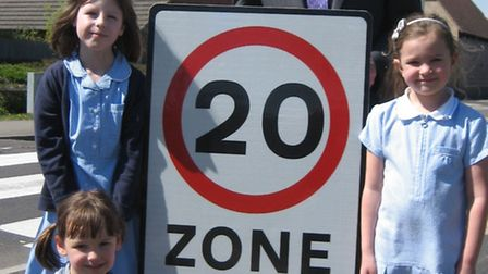 Pupils from Gothic Mede Lower School with Cllr Tony Brown and the signs they designed