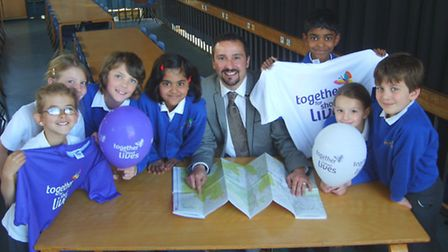Headteacher Richard Cano with pupils at the school