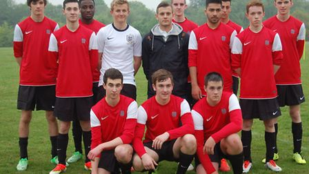 Jack Wilshere with The Priory School team, including Jason Kelly who's wearing the new shirt
