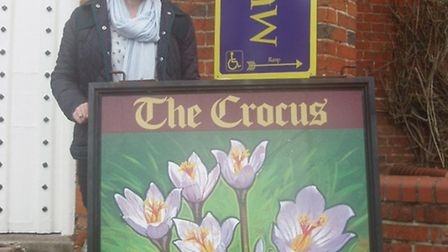 Saffron Walden Museum's Amy Glover with the iconic sign from the town's former Crocus Tavern pub.