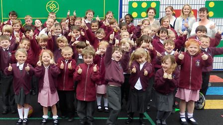 Staff and children of Finchingfield Primary School celebrate the impressive Ofsted report