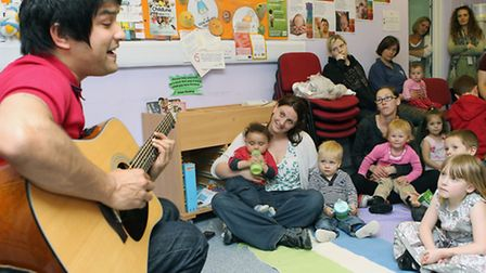 Nadeem Leigh performs to an audience of parents and children at Home-Start Stevenage
