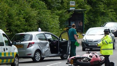 Police and a paramedic at the scene of the crash in Gresley Way, Stevenage. Picture: David Stuckey