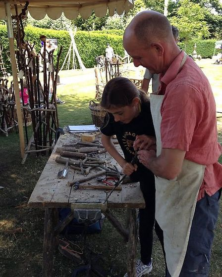 Andy Basham of Coppice Designs with a novice woodworker