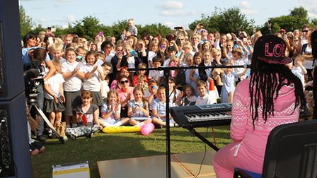 Gabz performs to a large crowd at Lodge Farm Primary School summer fair