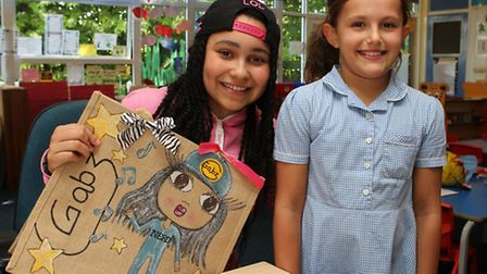 Gabz with Lodge Farm pupil Brooke George who gave Gabz a customised bag
