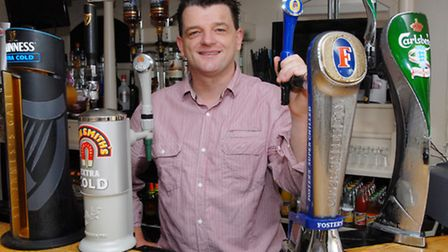 Gerry McGrath behind the bar at The Poacher