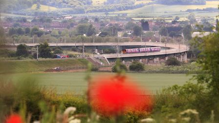 One of the first trains goes over the Hitchin flyover after its completion