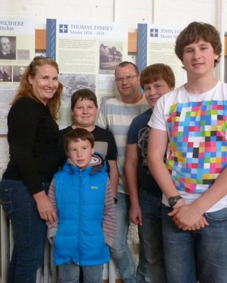 Thomas Dimsey's family outside the display dedicated to him