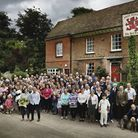 Thirty years on, shareholders and villagers stand outside their pub