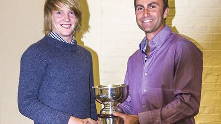 Tom Wilson (left) receives the trophy from Paul Bishop, director of tennis at Hitchin Boys' School T