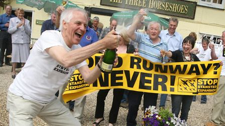 Peter Riding pops open the champagne back in May 2010 after Stop Stansted Expansion were victorious