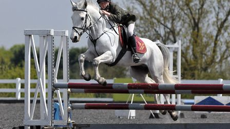 Wisbey Wisbey clears a jump and qualifies for the National Finals. Credit Garry Bowden/Sportinpictu