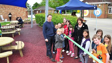 Cllr Judi Billing opens the fayre with acting headteacher Chris Kronda and pupils
