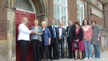 Cllr Lynda Needham (l) hands over the keys to Alison Gentle, with NHDC councillors and members of BT