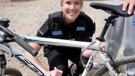PC Hannah Griffiths security marks a residents' bike