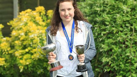 Eleanor Wase pictured at home with her medals and trophies from swimming county championships
