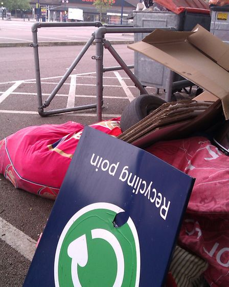 Rubbish dumped next to the recycling point in Sainsbury's car park