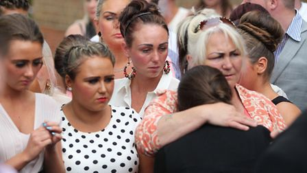 Friends and family comfort Thomas Ward's widow as his coffin is loaded into the hearse