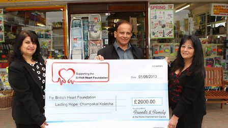 Bharti, Kamlesh and Mona Kotecha with a cheque for the British Heart Foundation