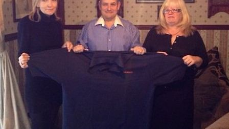 Harry Langridge showing off one of his old shirts with Lyn Mcleod and wife Linda