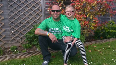 Trevor Collett and his eight-year-old daughter Izzy will be taking park in the Macmillan 10k fun run