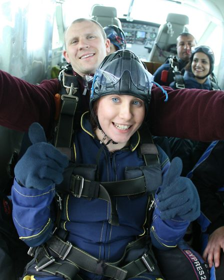 Charlotte Golding: Thumbs-up in the plane.