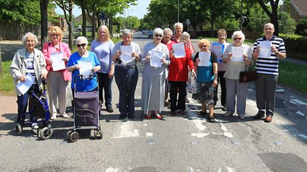 Residents holding a petition calling for potholes in Broadwater Crescent to be repaired