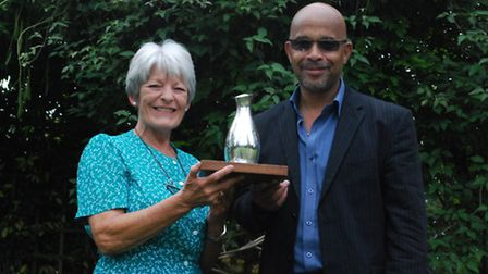 Owner of Chilford Hall, Fiona Alper, and general manager, Glen Mejias, celebrate winning an award fo