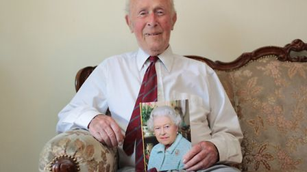 Reginald Allen at home with his 100th Birthday card from the Queen
