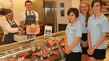 Linton Village College students with their award winning sausages now on sale in Waitrose.