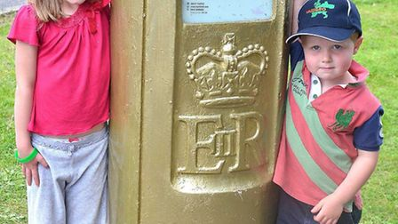 Alice and Robert Parrish next to the golden postbox