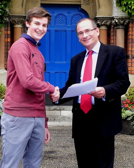 Headmaster Dr Mike Walker with pupil Sam Mitchell