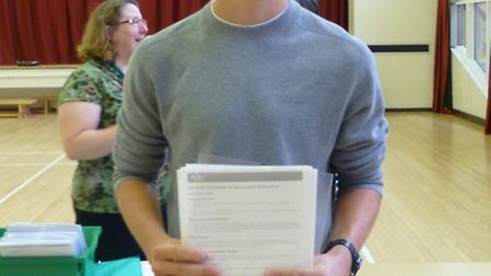 Head boy Sam James with his results