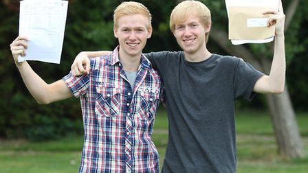 Twin brothers Ryan Twomey and Liam Twomey with their results