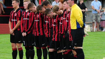 The players observe a minute's silence