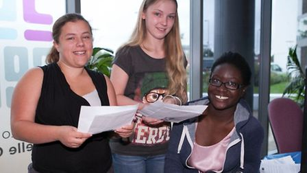 North Hertfordshire College students are over the moon with their results. From L-R: Emma Page, Kirs