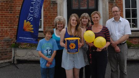 Laura Weekes with members of her family and St Clare Hospice community fundraiser Sarah Calder.