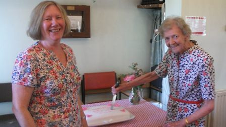 Stansted Day Centre's oldest surviving user and past volunteer Jane Sell (right) cutting a celebrato