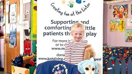 Pictured Bella the dog in her new Magic of Play jacket, and childrens' ward patient Mae Evison