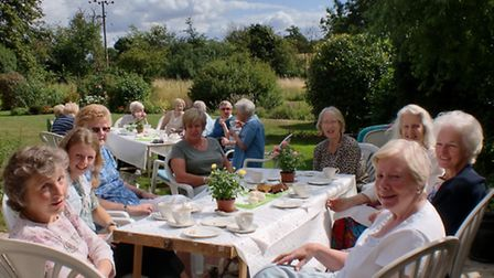 Attendees enjoy the sunshine and tea at the coffee morning fundraiser