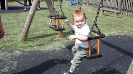 One of the younger attendees enjoys a go on the swing