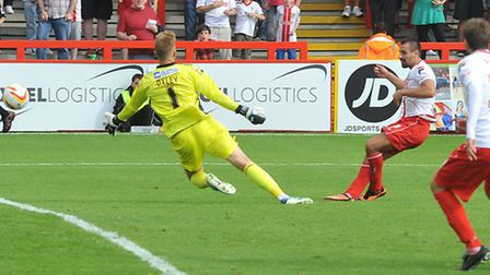 Filipe Morais scores the equaliser for Boro against Oldham on the opening day of the season. Photo: