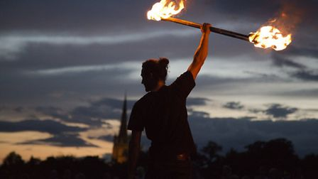 Fire performer on the turf labyrinth on Sunday evening.