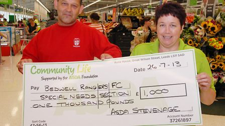 Roy Small, manager of Bedwell Rangers FC's inclusion team, recieves a cheque from ASDA community lif