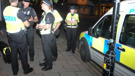 Police officers outside the Temeraire pub on the High Street.